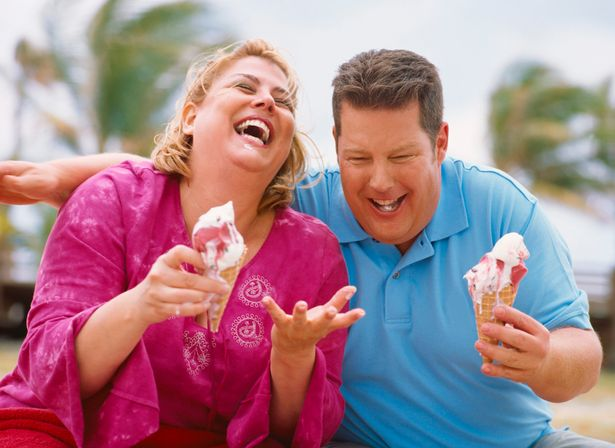 Overweight-couple-eating-ice-cream-cones